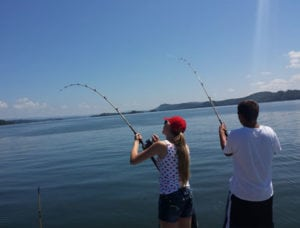 Young couple fishing in Cherokee Lake in East Tennessee