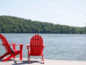 Two red chairs sit next to Watts Bar Lake